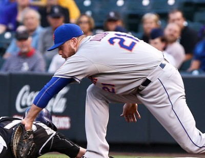 DENVER-AUG 21: New York Mets firstbaseman Lucas Duda tags out Co