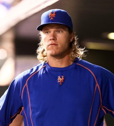 DENVER-AUG 21: New York Mets pitcher Noah Syndergaard in the dug